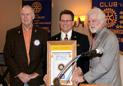 "CELEBRATING a big milestone, Fred Heitman, Rotary district governor, right, honors the Bradley Sunrise Rotary Club for becoming a ""100 Percent Paul Harris Fellow Club."" Joining him, from left, are club Rotary International Foundation chairman Andy Anderson and Kevin Mendel, club president."