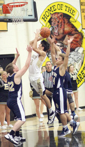 BRADLEY CENTRAL freshman Saylor Clark (25) splits a trio of Soddy-Daisy defenders for two of his six points in Tuesday evening's 79-46 Bear victory at Jim Smiddy Arena.
