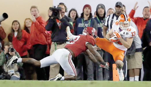 Clemson's Hunter Renfrow caught the winning touchdown pass in front of Alabama's Tony Brown with one second left in the national championship game Tuesday, in Tampa, Fla.