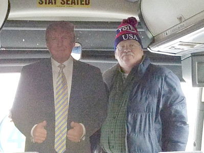 "Constable Garry Moore is joined by a ""special guest"" on the bus he drove to the Trump Inaugural celebration bearing Bradley and Hamilton County Republicans."