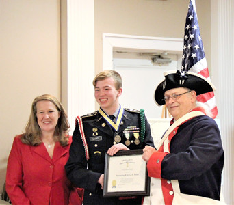 JROTC Cadet Bret Lloyd was presented the Col. Benjamin Cleveland Chapter of Sons of the American Revolution Outstanding JROTC Medal. From left are  Lloyd's mother, Kyra Rasnake; Lloyd; and Jim McKinney.