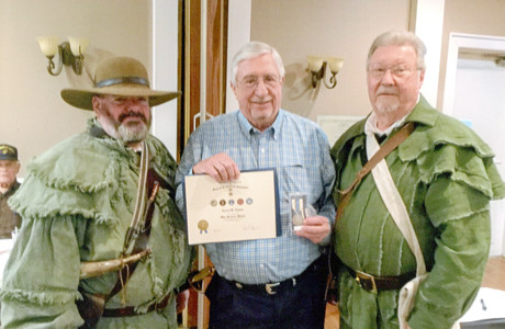 LARRY TATUM, center, received a Korean Service Corps Certificate of Patriotism and a SAR War Service Medal. Making the presentation was Hjellum, Veterans Committee chair, right, and President John A. Clines Sr.