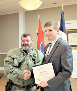 "Col. Benjamin Cleveland Chapter of Sons of the American Revolution President John A. Clines Sr. gives Hunter McLain, chapter chaplain, a certificate of appreciation following his program on ""Tragedy at Cavett's Station."""
