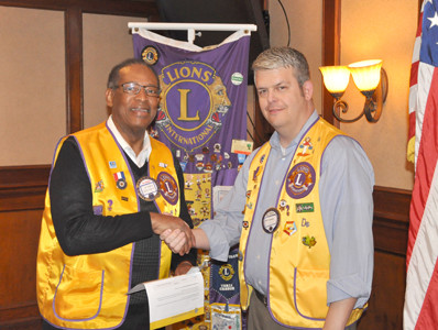 LIONS AVERY Johnson, left, was presented the Centennial membership Award from the Cleveland Lions Club. Making the presentation is Lion President Matt Connell. The Silver Centennial Award is form recruiting and retaining new Lions.