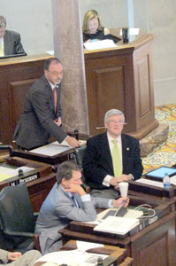 State Sen. Mike Bell, rear,  finishes a presentation on the Senate floor while his colleague, state Sen. Todd Gardenhire, listens. In the foreground is state Sen. Mark Green.