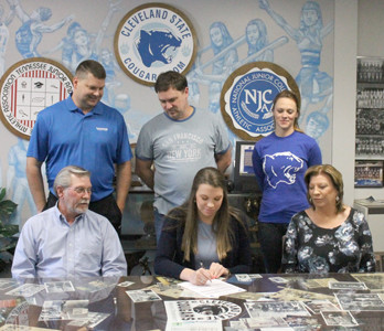 FORMER BRADLEY CENTRAL standout Monica Johnson, seated center, signs her National Letter of Intent to play for Cleveland State's newly formed volleyball team. Witnessing the signature Friday afternoon were her parents, seated, Bo and Margie Johnson, as well as coaches, standing from left, Randy Evans (CSCC head coach), Robert Catlett (Scenic City VB) and Alizabeth Atnip (CSCC assistant).