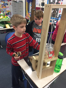 Ben Anderson, left, and his family made a leprechaun trap with simple machines for Mrs. Ronda Phillips' second grade class at Yates Primary