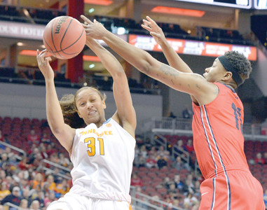 Tennessee's Jaime Nared (31) battles Dayton's Alex Harris, right, for a rebound in the first half of their first-round women's NCAA tournament game Saturday, in Louisville, Ky.