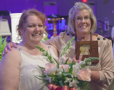 PATTI GLADSON, left, is presented one of two Volunteer of the Year awards by Sandee Williams, client services assistant, at the New Hope Spring Banquet.  The other recipient of the Volunteer of the Year award was Waneva Bradbury, not pictured.