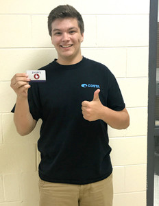 TRISTAN GIVENS of Bradley Central High School displays the $15 Zaxby's card he won at his school's ACT breakfast.