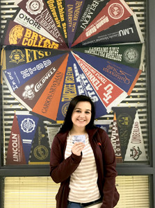 RAVEN PEELS shows off the $25 Visa card she won during Bradley Central High School's recent ACT breakfast.