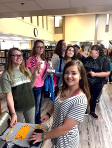 STUDENT COUNCIL members at Bradley Central High School sharpen and hand out pencils to peers during the school's ACT breakfast.