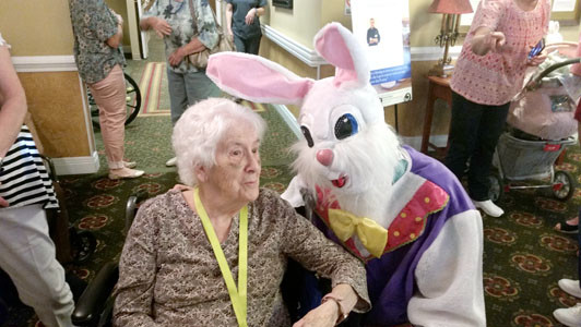 Resident Lisa McGarvey listening to a story from the Easter bunny.