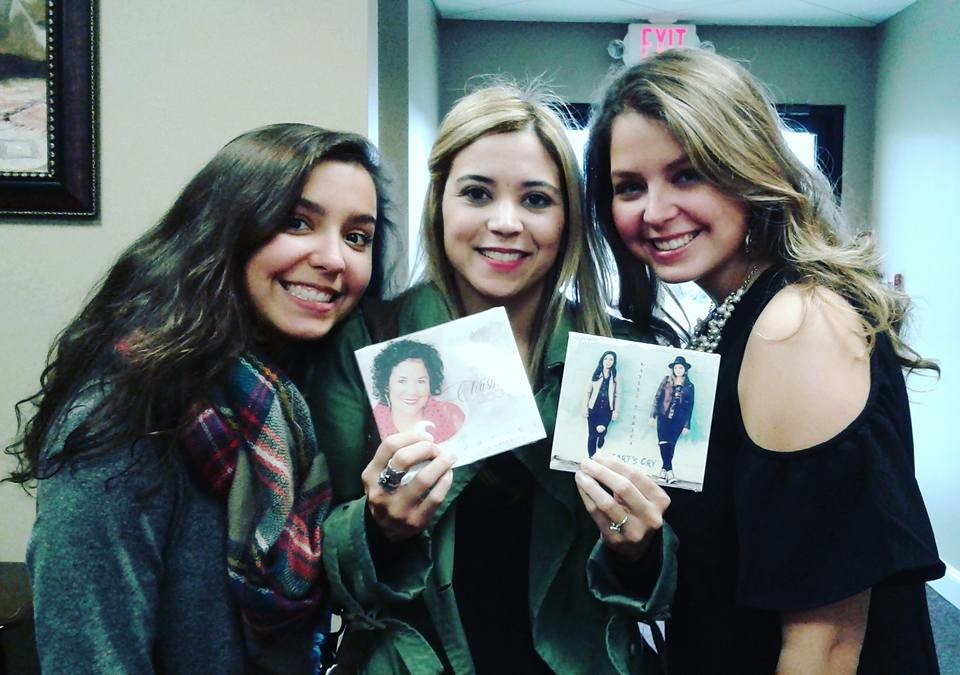 JANET MERCADO is seen with friends Kaylee Tuttle, left, and Erica Tuttle, right, celebrities on Christian radio. The girls are celebrating the release of Kaylee and Erica's recent CD. Mercado, better known as Janet JM, is working on her second album