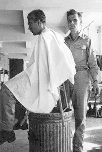 An old photo of Watson's father, Jeff Horne cutting hair in the Army. The Hornes have a history of cutting and styling hair.