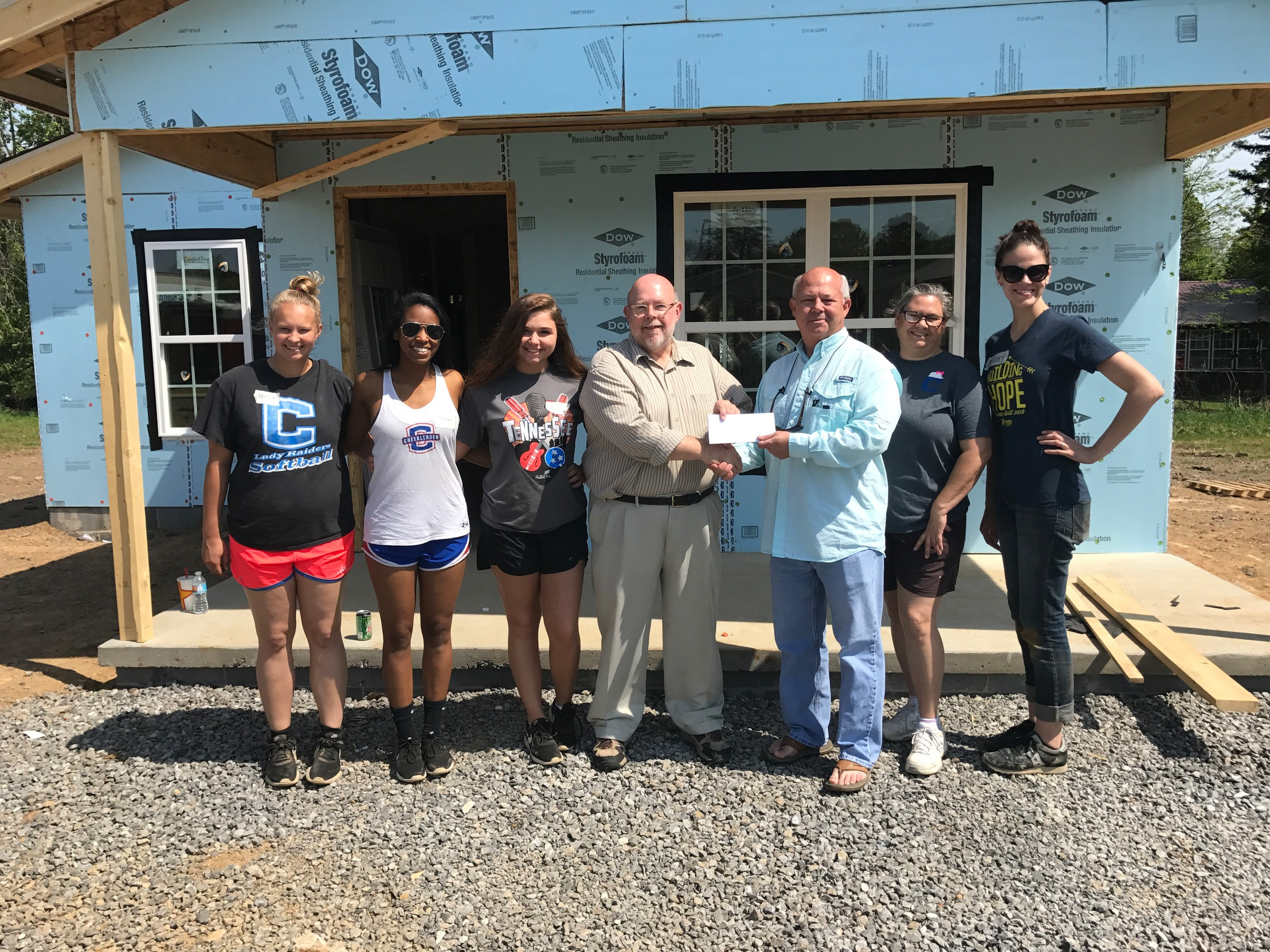 CLEVELAND HIGH SCHOOL'S Habitat For Humanity Women's Build team was sponsored by Southeast Bank. Standing, from left, are Ambra Belcher, Tehya Dyer, Josey McCluskey, Chip Willis (Habitat Executive Director), DeWayne Morrow (Southeast Bank City President), Cari Bosserdet, and Mallory Pickert.