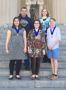 CELEBRATING their first-place Tennessee History Day wins, Lake Forest Middle School students join their sponsors for a photo at the War Memorial Auditorium in Nashville. In front, from left, are Jaylin Viviano, Paige Frady and Chase Hagler. Joining them are teachers Jason Viviano and Julie Mitchell.
