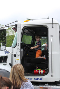 THREE-YEAR-OLD Caysen Garner smiles at his mom while sitting in the driver's seat of a cement truck.