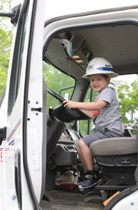 JUST LIKE DAD: 5-year-old Creed Goins enjoyed wearing his dad's hard hat while sitting in the VEC rig at Big Truck Round-Up.