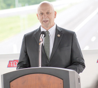 U.S. REP. SCOTT DESJARLAIS offers some encouraging words to Mayor Tom Rowland at the interchange dedication.