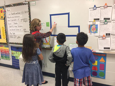 STUDENTS in Mrs. Barnette's class at E.L. Ross Elementary School were busy recently, learning about area and perimeter.