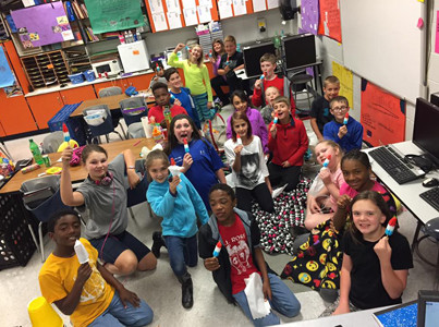 MRS. DAVIS' CLASS at E.L. Ross Elementary School enjoyed their treats for being the class with the best attendance and the least amount of tardies and check-outs for the month of April.