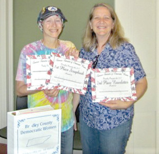 Local winners were Jamie Hargis, left, for first-place in the scrapbook competition and Angela Minor, right, second place in the newsletter competition.
