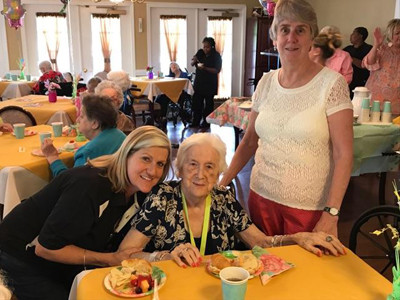 Brenda and Dorin, daughters of Lisa McGarvey, center, enjoyed the festivities with their mom.