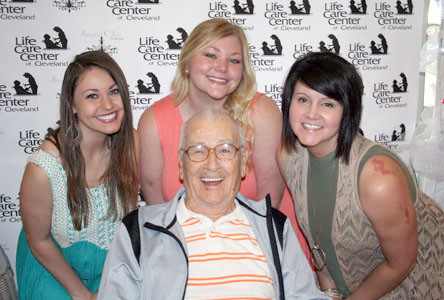 Claude Ogle, above right, is surrounded by Victoria Jones, Makayla Parris and Christel Hudgins.