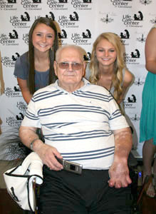 ROBERT LEE, left photo, is surrounded by Sydney Morgan and Allie Poteet.