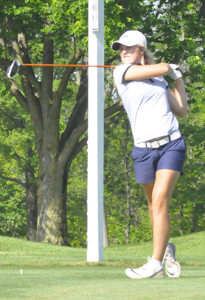 LEE UNIVERSITY junior Caroline Moore rips a drive on the par-4 13th hole at the Findley (Ohio) Country Club during Thursday's second round of the NCAA Division II National Championship.
