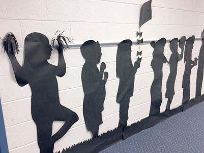 STUDENTS WERE ALLOWED to pose however they wanted for the shadow tracing.