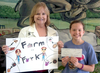 MACY BIVENS, a student at North Lee Elementary School, was the first-place winner for the fourth-grade agriculture poster contest held by the Bradley County Farm Bureau in partnership with the University of Tennessee Extension Office. She is pictured here with Dianne Sanders, Farm Bureau women's chair.