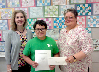 NOAH PEREZ, a student at Lake Forest Middle School, won second place in the middle school agriculture essay contest held by the Bradley County Farm Bureau in partnership with the University of Tennessee Extension Office. He is pictured with teacher Dr. Julie Mitchell and Carolyn Earnest, Farm Bureau women's chair.
