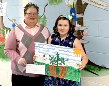 OLIVIA PASS, a student at Charleston Elementary School, won second place in the fourth-grade agriculture poster contest held by the Bradley County Farm Bureau in partnership with the University of Tennessee Extension Office. She is pictured with Carolyn Earnest, Farm Bureau women's chair.