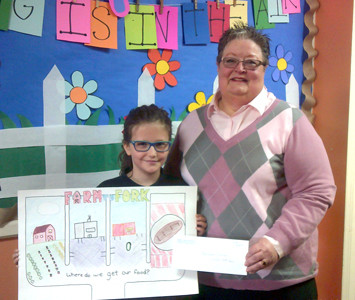HANNAH CAINES, a student at Tennessee Christian Preparatory School, was the third-place winner in the fourth-grade agriculture poster contest held by the Bradley County Farm Bureau with the University of Tennessee Extension Office. She is seen here with Carolyn Earnest, Farm Bureau women's chair.
