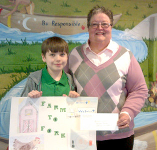 NATHAN KELLER, a student at Waterville Community Elementary School, received an honorable mention in the fourth-grade agriculture poster contest held by the Bradley County Farm Bureau and the University of Tennessee Extension Office. He is joined here by Carolyn Earnest, Farm Bureau women's chair