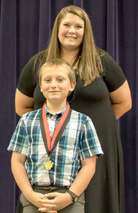 SCIENCE AWARD recipient Jackson Knoll was recently honored at Stuart Elementary School. Presenting him the award is teacher Kristin Gowin.