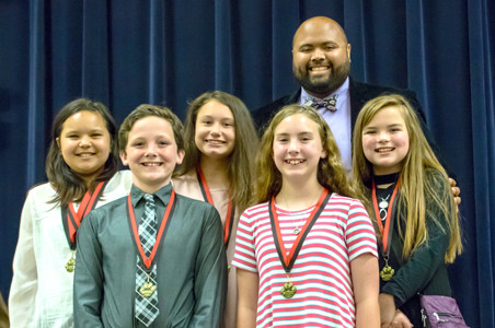 MUSIC AWARDS were given to students, from left, Indiesa Gasaway, Patrick Reeder, Madison Lane, Alayna Itson and Alanah Davis recently at Stuart Elementary School. Teacher Jay Garcia, in back, presented the awards. A previously published version of this photo caption omitted a name.