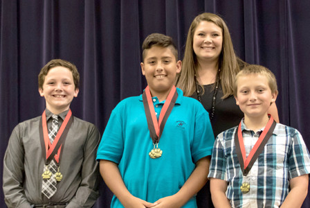 SOCIAL STUDIES AWARD recipients, from left, Patrick Reeder, Ethan Bilbao and Jackson Knoll were recognized recently at Stuart Elementary School. Joining them is teacher Kristin Gowin.