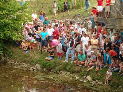 Gathering along the banks of Mouse Creek has become a much-anticipated moment during the Great Cleveland Duck Race.
