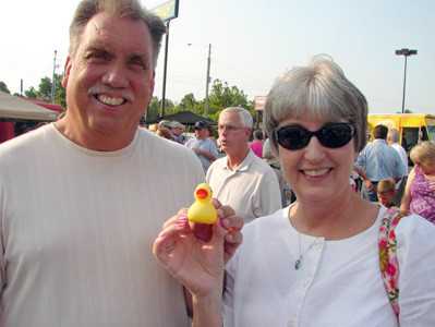 Jerry and Janice Baker show off their entrant during one of the recent Great Cleveland Duck Races. Former Cleveland Utilities President/CEO Ken Webb is in the background.