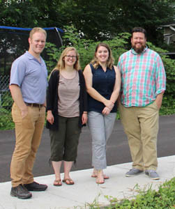 IMPACT CLEVELAND will be embarking on the next stage of their mission of neighborhood revitalization thanks to a $500,000 grant from Project Reinvest: Neighborhoods. Standing, from left, are Dustin Tommey, executive director; Melanie Brubaker, Impact Cleveland VISTA; Brittany Cox, administrative assistant; and Jake Stum, director of special projects.