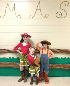 THE SAPP FAMILY supported the Michigan Avenue Elementary School PTO in their sweet costumes during this past school year's Western-themed fundraising auction.