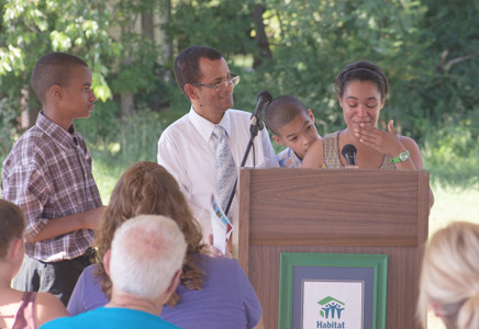 RHINA BASURA of the Basura family becomes emotional while delivering remarks on behalf of the three families honored at the dedication.  From left are Jose Basura Jr., Jose Basura, Rhina  and Jesse.