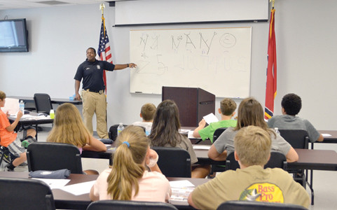 CPD OFFICER Julius Porter talks to boys and girls attending the department's Youth Academy about gangs.