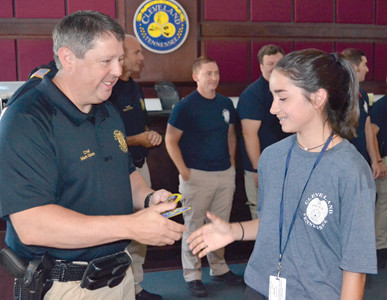 CLEVELAND POLICE CHIEF Mark Gibson congratulates cadet Delaney Rose during graduation ceremonies Friday for the CPD Youth Academy.