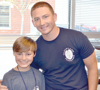 SEVERAL YOUNGSTERS, including Baylor Thompson, were honored for completing the CPD Youth Academy at Friday's graduation. Thompson said that his favorite instructor was Bobby Ruth, right.