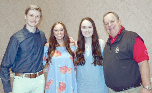 INCOMING COLLEGE FRESHMEN who received Ratterman-Shell scholarships Friday were, from left, Will Kaylor, Samantha Eason and Kaley Walker, along with scholarship committee chairman Mark Smith.
