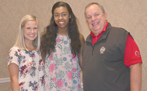 COMMITTEE CHAIRMAN Mark Smith, far right, presented scholarship stipends to rising juniors, from left, Ashley Shoemaker and Jada Blackwell, at Friday's Ratterman-Shell scholarship dinner. Also receiving a scholarship as he becomes a junior is Blake Kitterman.